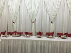 Rental store for 10  Hi x 10  Drape Ivory w Red Backdrop in Allentown PA